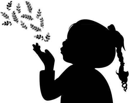 a child blowing out leaves, silhouette