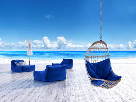 Photo for Beach lounge deck with sunbeds umbrella and hanging chair with sea view - Royalty Free Image