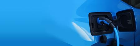 Foto de Electric car charging on charge station, electro mobility environment friendly, copy space - Imagen libre de derechos