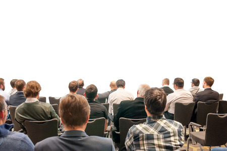 Foto de silhouettes of the people sitting back on the business conference isolated on white - design for your presentation - Imagen libre de derechos