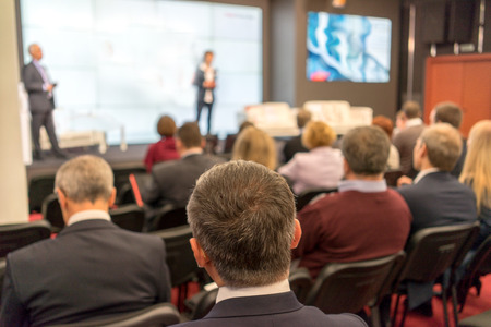 Foto de The audience listens to the acting in a conference hall - Imagen libre de derechos