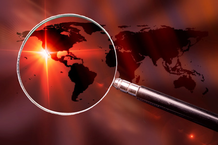 Foto de World map with magnifying glass - conceptual global search image. - Imagen libre de derechos