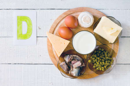 Photo pour Foods containing vitamin D: cheese, eggs, mushrooms, milk, butter, peas canned in oil - image libre de droit