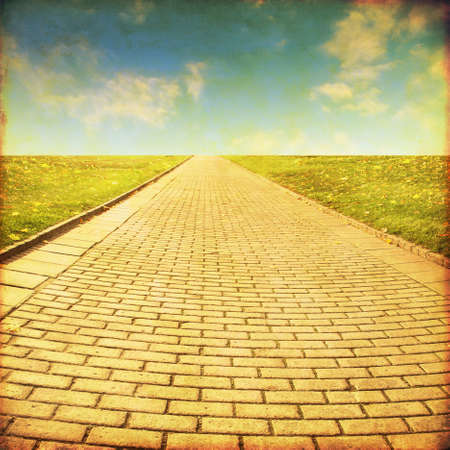 Foto de Stone pathway in the field.Grunge and retro style. - Imagen libre de derechos