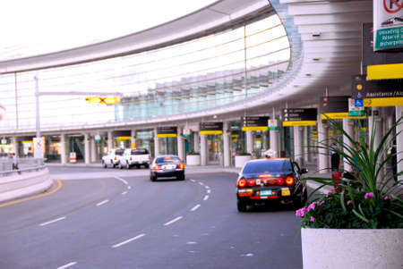 Airport terminal with cars outside