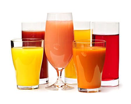 Various glasses of juices isolated on white background