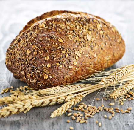 Loaf of fresh baked multigrain bread with grain ears