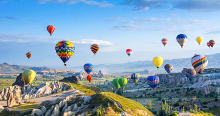 Photo for The great tourist attraction of Cappadocia - balloon flight. Cappadocia is known around the world as one of the best places to fly with hot air balloons. Goreme, Cappadocia, Turkey - Royalty Free Image