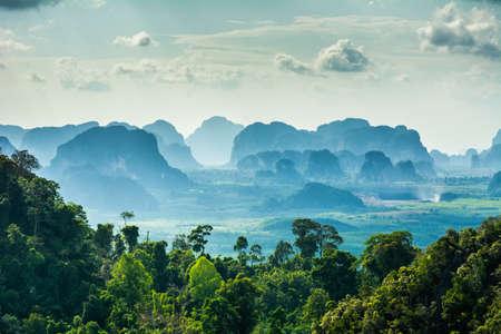Foto de Amazing view from Wat Tham Seua (Tiger Cave Temple), Krabi province, Thailand. Beautiful silhouettes of mountains - Imagen libre de derechos