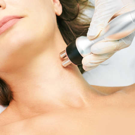 Photo for Dermatology skin care facial therapy. Medical spa anto wrinkles procedure. Woman face rejuvenation. Pretty girl. Rf cosmetician equipment. Chin and neck. - Royalty Free Image