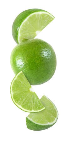 Foto de hanging, falling and flying piece of lime fruits isolated on white background - Imagen libre de derechos