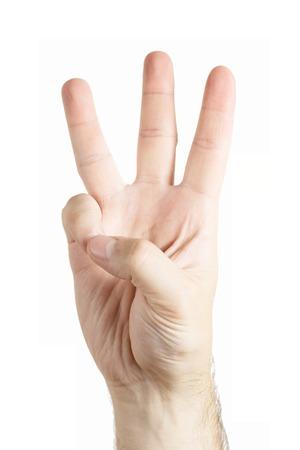 Foto de Human hand gesture isolated. Three fingers. Counting. - Imagen libre de derechos