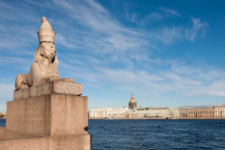 Photo for An ancient 3500 year old Egyptian sphinx positioned on the University Embankment next to the Neva river with a view on the city's quayside, Saint Petersburg, Russia - Royalty Free Image