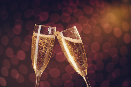 Photo for Two elegant champagne glasses making toast on holiday bokeh background - Royalty Free Image