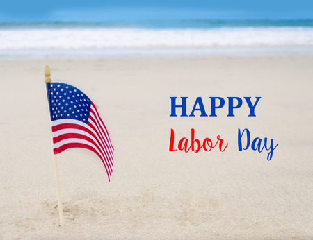 Photo pour Labor Day USA background with American flag on the sandy beach - image libre de droit