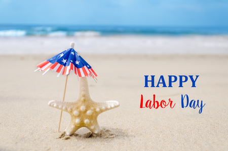 Photo for Labor Day USA background with starfishes and decorations on the sandy beach - Royalty Free Image