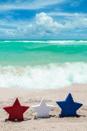 Photo pour Patriotic USA  with decorations on the sandy beach - image libre de droit