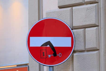 Foto de Road sign with an arm that comes out from signal, street art, metropolitan art - Imagen libre de derechos