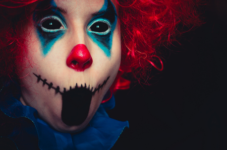 Photo for Creepy clown close up spooky halloween portrait on black background - Royalty Free Image