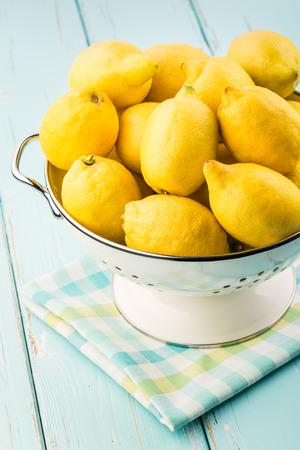 Photo for Fresh lemons in retro colander  - Royalty Free Image