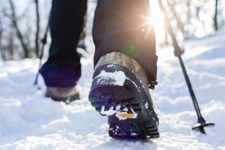 Foto per Winter hiking. Lens flare, shallow depth of field. - Immagine Royalty Free