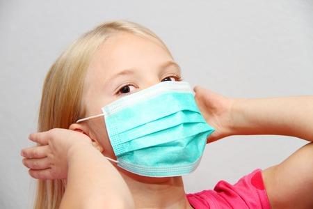 Photo for Little girl wearing a protective mask - Royalty Free Image