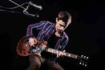 Photo for Man playing guitar during concert - Royalty Free Image