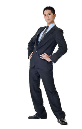 Full length of a handsome business man of Asian standing with funny pose against white.