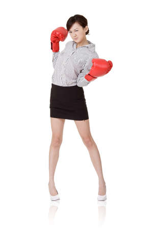Business woman fight with boxing gloves, isolated on white background.