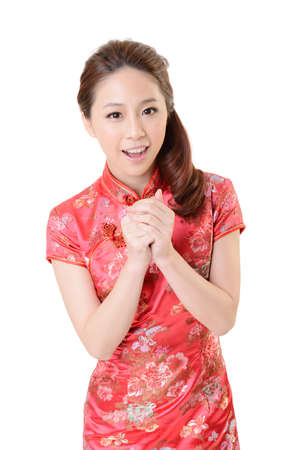 Photo for Smiling Chinese woman dress traditional cheongsam at New Year, studio shot isolated on white background. - Royalty Free Image