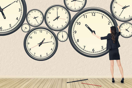 Photo pour Asian business woman repair the clock, concept of time management, rebuild, busy etc. - image libre de droit