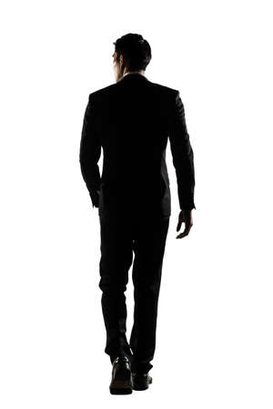 Photo for Silhouette of Asian business man walk with confidence, full length portrait isolated on white. Rear view. - Royalty Free Image