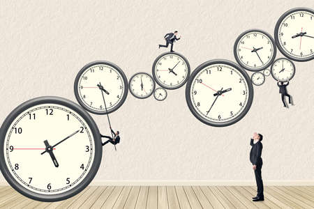 Photo pour Asian business man try his best to do the time management. Photo compilation using the same model. - image libre de droit