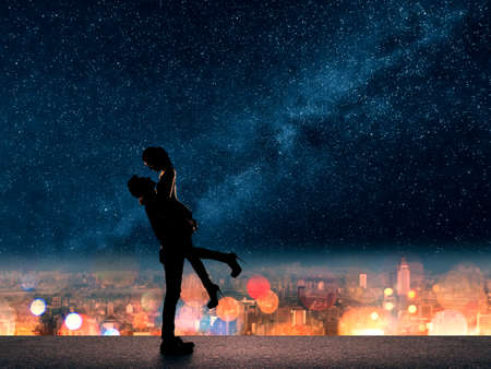 Photo for Silhouette of Asian couple, man hold his girlfriend up above the city in night under stars. - Royalty Free Image