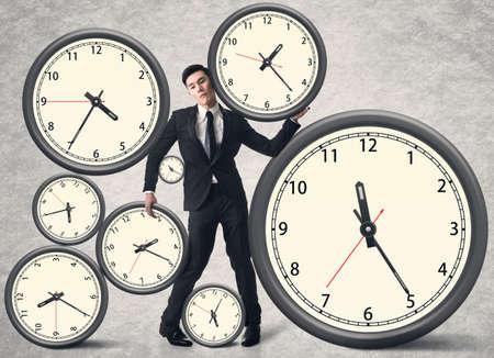 Photo pour Time pressure concept, Asian business man with many clocks. - image libre de droit
