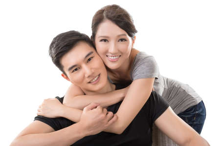 Photo pour Attractive young Asian couple, closeup portrait on white. - image libre de droit