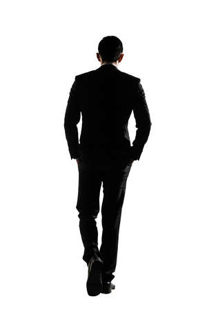 Photo pour Silhouette of Asian business man walk with confidence, full length portrait isolated on white. Rear view. - image libre de droit