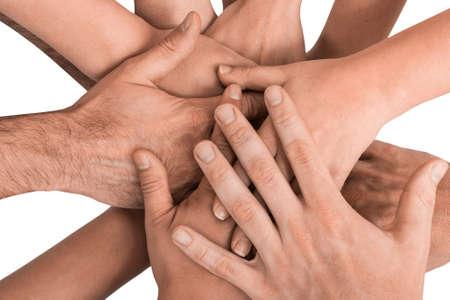 Foto de Group of hands holding together on white background. - Imagen libre de derechos