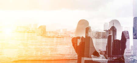 Photo pour Silhouette of two businesswomen stand and look far away in Hong Kong, Asia. Double exposure. - image libre de droit