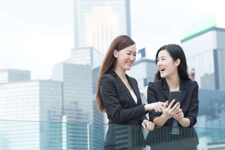 Photo for Asian business women talking to each other in Hong Kong, Asia. - Royalty Free Image