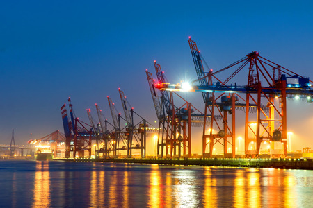 Photo for Container cranes in Hamburg harbor at night - Royalty Free Image
