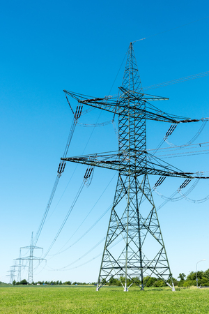 Photo pour Electric pylons and transmission lines seen in Germany - image libre de droit