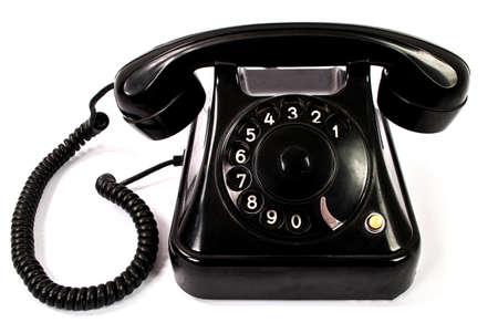 Photo pour Old retro black phone isolated on a white background - image libre de droit