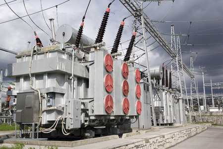 Photo pour Electrical power transformers in high voltage substation. - image libre de droit