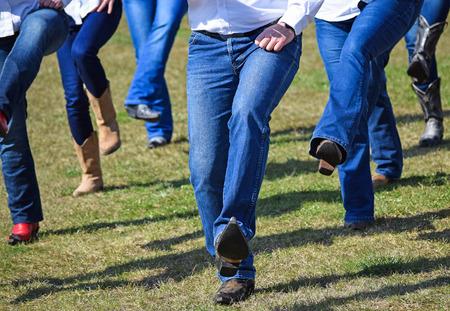 Photo pour Western dancers show outdoors - image libre de droit