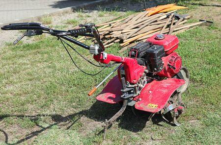 Photo pour Cultivator machinery on the grass - image libre de droit