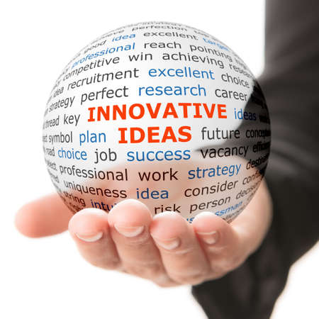 Foto de Concept of innovative ideas in business. Words on the transparent ball in the hand - Imagen libre de derechos