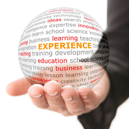 Foto de Concept of experience. Wordcloud on the transparent ball in the hand - Imagen libre de derechos