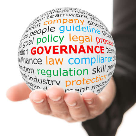 Foto de Governance concept. Hand take white ball with wordcloud and governance word in red color. - Imagen libre de derechos