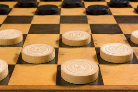 Photo for Black and white wooden pieces in the starting position on a checkerboard - Royalty Free Image